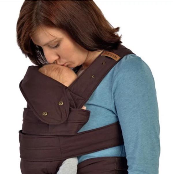 mom kissing baby In Sling
